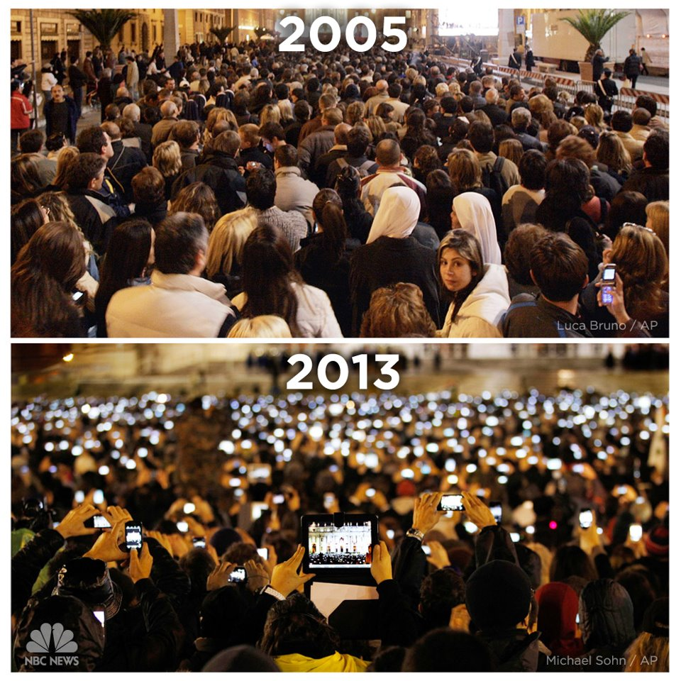 picture of the 2005 election of pope benedict xvi and the 2013 election of pope francis I, with an accent on the rise of mobile media's presence, particularly the many smart phones used by the crowd.